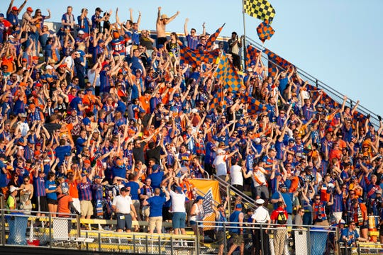 Aug 10, 2019; Columbus, OH, USA; FC Cincinnati fans celebrate after a goal by forward Darren Mattocks (11) against Columbus Crew SC at MAPFRE Stadium.