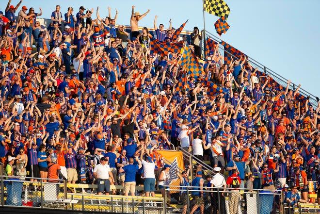 Aug 10, 2019; Columbus, OH, USA; FC Cincinnati fans celebrate after a goal by forward Darren Mattocks (11) against Columbus Crew SC at MAPFRE Stadium.