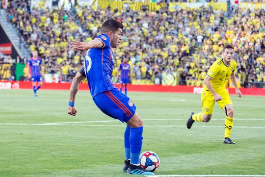 Aug 10, 2019; Columbus, OH, USA; FC Cincinnati midfielder Emmanuel Ledesma (45) kicks and scores a goal in the first half of the match against the Columbus Crew SC at MAPFRE Stadium.