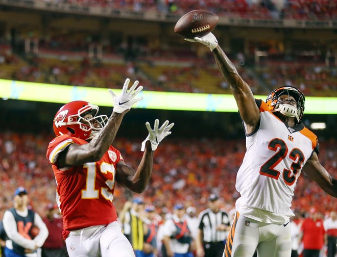 Cincinnati Bengals cornerback Darius Phillips (23) breaks up a pass intended for Kansas City Chiefs wide receiver Byron Pringle (13) during the first half at Arrowhead Stadium.