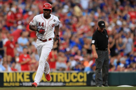 Cincinnati Reds' Aristides Aquino runs the bases after hitting his second home run of the game, during a baseball game against the Chicago Cubs, Saturday, Aug. 10, 2019, in Cincinnati. The Reds won 10-1.