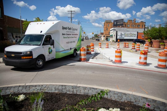 A trucks comes off eastbound Kercheval onto the roundabout at Wayburn Street in Grosse Pointe Park. Kercheval will soon be open to two-way traffic between Grosse Pointe Park and Detroit.