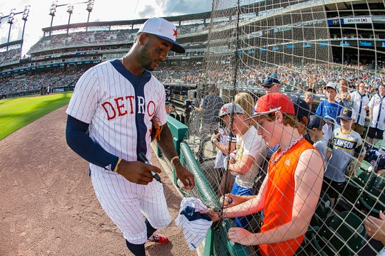 Niko Goodrum #28 of the Detroit Tigers signs autographs for fans before a MLB game against the Kansas City Royals at Comerica Park on August 10, 2019 in Detroit, Michigan. The game tonight is the 25th Annual Commemorative Negro League Game.