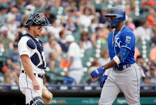 Royals' Jorge Soler crosses home plate past Tigers catcher John Hicks after hitting a solo home run during the eighth inning Sunday.