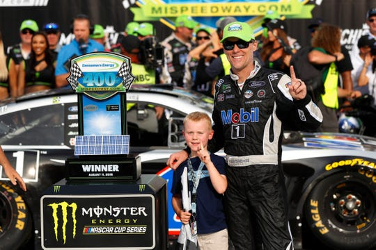 Kevin Harvick celebrates with his son, Keelan, after winning a NASCAR Cup Series auto race at Michigan International Speedway in Brooklyn.