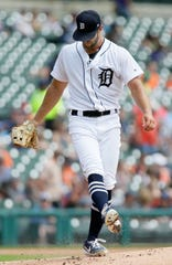 Daniel Norris kicks at the mound after giving up a solo home run to Royals' Hunter Dozier during the first inning Sunday.