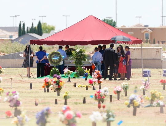 Family and friends gather for a funeral service for Jordan Anchondo at Evergreen Cemetery in El Paso, Texas on Saturday, Aug. 10, 2019.