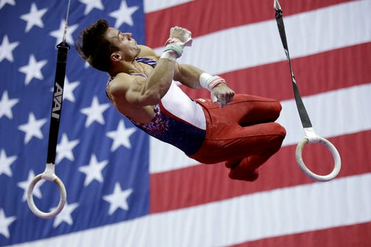 Samuel Mikulak competes on the rings.