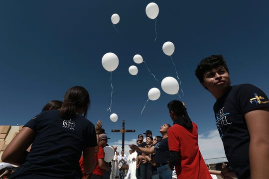 Faithful release balloons during a Mass for peace, in Ciudad Juarez, Mexico, Saturday, Aug. 10, 2019, marking the one week anniversary of a shooting that killed 22 at a Walmart in El Paso. Authorities say the man accused of carrying out last weekend's deadly mass shooting confessed to officers that he had been targeting Mexicans.