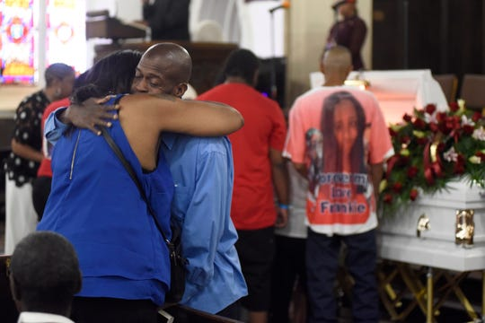 Pastor Barry Randolph hugs Sherrie Scott, the mother Francesca Marks, who died shielding her children from gunfire,  at Church of the Messiah in Detroit.