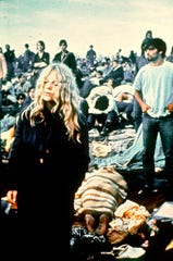 In this August 1969 file photo, rock music fans listen to performers at the Woodstock Festival of Arts and Music in Bethel, N.Y.