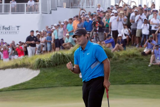 Patrick Reed pumps his fist on the 18th hole as he wins The Northern Trust on Sunday.