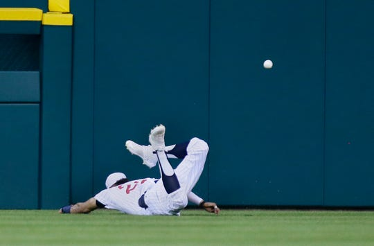 Tigers center fielder Victor Reyes makes a diving attempt on a fly ball hit by Kansas City's Hunter Dozier during the eighth inning Saturday.