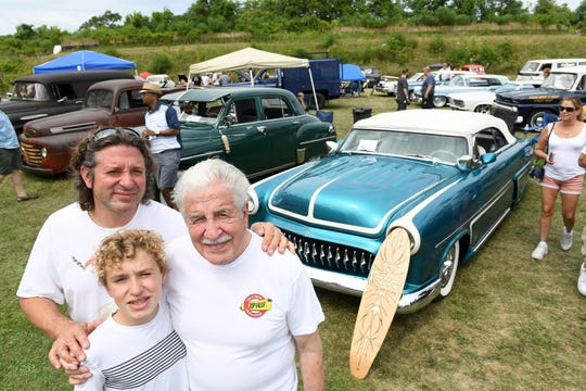 Three generations of Gambinos, from top left, Todd with his father, Sam, a pinstriper of cars since 1956, and son, Chris, 13, in front of Todd's 1953 Ford Sunliner at the fifth annual Motor Show at Historic Fort Wayne in Detroit on Aug. 11, 2019.  Todd and Sam attended a car show at Historic Fort Wayne in 1989 and 1990 and thought it would be fun to come back.