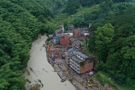 Rescuers search for victims of a landslide triggered by Typhoon Lekima in Yongjia county in eastern China's Zhejiang province on Saturday, Aug. 10, 2019. The official Xinhua News Agency says more than 1 million people were evacuated in coastal Zhejiang province before the typhoon hit land at 1:45 a.m. on Saturday.