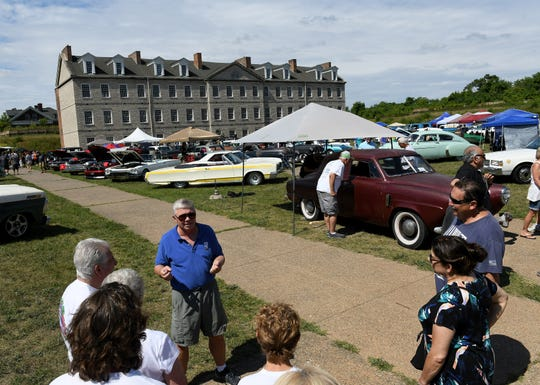Historical researcher and tour director David Jamroz, left, gives a tour during the fifth annual Motor Show at Historic Fort Wayne in Detroit on Aug. 11, 2019.