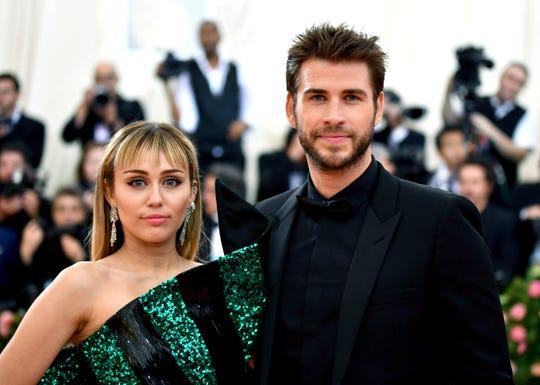 Miley Cyrus, left, and Liam Hemsworth.