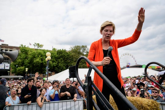 U.S. Sen. and 2020 democratic presidential candidate Elizabeth Warren, D-Mass., waves goodbye as she walks off the stage at the end of her speech on the Des Moines Register Political Soapbox at the Iowa State Fair in Des Moines, Iowa, Saturday, Aug. 10, 2019.