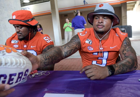 Clemson defensive lineman Xavier Thomas (3)  signs autographs during Clemson football Fan Appreciation Day in Memorial Stadium Sunday, August 11, 2019.