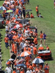 People line up to get autographs from the quarterbacks, including starter Clemson quarterback Trevor Lawrence (16) during Clemson football Fan Appreciation Day in Memorial Stadium Sunday, August 11, 2019. The first one in line was there the night before at 9:45 p.m. for a 2:30 p.m. start.