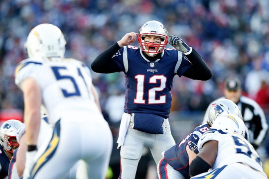 Tom Brady changes a play at the line of scrimmage in a dominating AFC playoff win against the Chargers on Jan. 13. He completed 34 of 44 passes in that game.