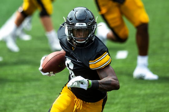 Iowa wide receiver Ihmir Smith-Marsette (6) catches a pass during a Hawkeyes football Kids Day scrimmage, Saturday, Aug. 10, 2019, at Kinnick Stadium in Iowa City, Iowa.