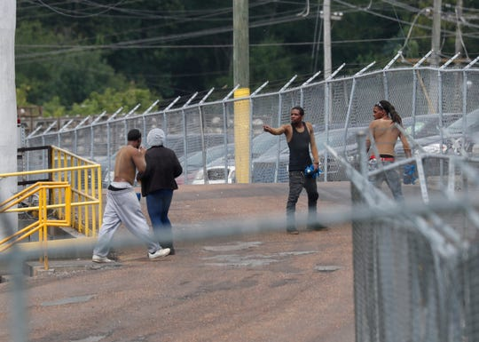 Workers exit Koch Foods Inc., processing plant in Morton, Miss., as business continues, Thursday, Aug. 8, 2019, following Wednesday's raid by U.S. immigration officials. In an email Thursday, U.S. Immigration and Customs Enforcement spokesman Bryan Cox said more than 300 of the 680 people arrested Wednesday have been released from custody. (AP Photo/Rogelio V. Solis)