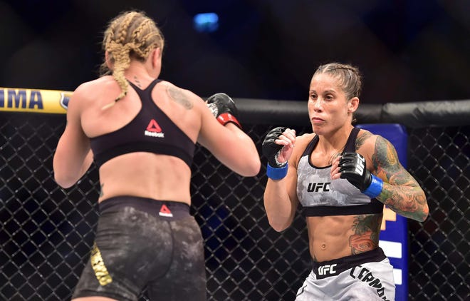 Liz Carmouche (right) fights Valentina Shevchenko in Saturday's main event during UFC on ESPN+14 at Antel Arena.