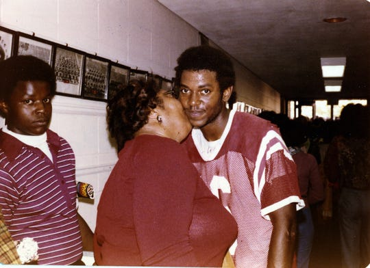 Family photo of Darryl Drake, fall of 1978 at Western Kentucky University. Darryl Drake's mother is kissing him.