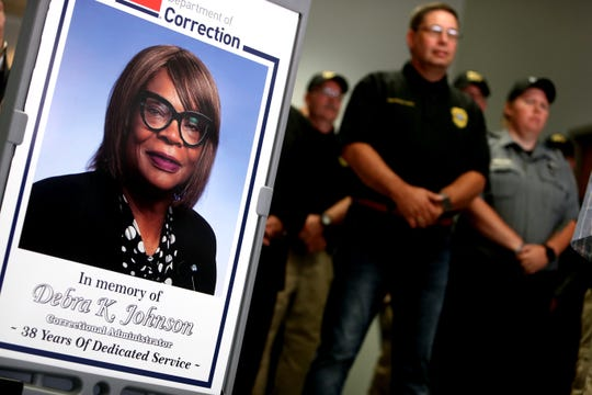 A sign picturing Debra K. Johnson, an administrator at the West Tennessee State Penitentiary Center is displayed at a press conference on Sunday, August 11, 2019, following the capture of Curtis Ray Watson.