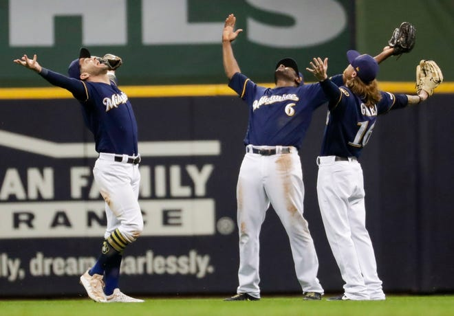 Brewers outfielders Ryan Braun, Lorenzo Cain and Ben Gamel celebrate a victory.