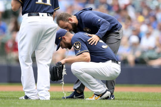 Brewers starting pitcher Adrian Houser  vomits on the field in the first inning.