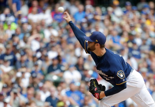 Brewers starting pitcher Jordan Lyles allowed only three hits in seven innings.