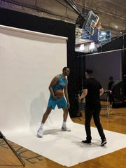 Charlotte guard P.J. Washington takes direction during a rookie trading-card photo shoot at FDU-Florham on Sunday.