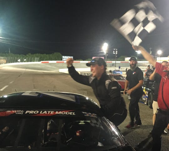 Jackson Boone celebrated after claiming the first win of his career in the featured pro late model division at Fairgrounds Speedway Nashville Saturday night.