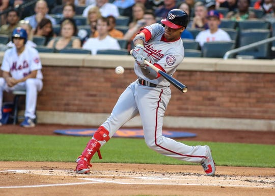 Aug 10, 2019; New York City, NY, USA; Washington Nationals left fielder Juan Soto (22) hits a two run home run in the first inning against the New York Mets at Citi Field. Mandatory Credit: Wendell Cruz-USA TODAY Sports