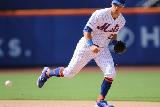 Joe Panik, of the Mets was unable to reach this ground ball against the Nationals. Sunday, August 11, 2019