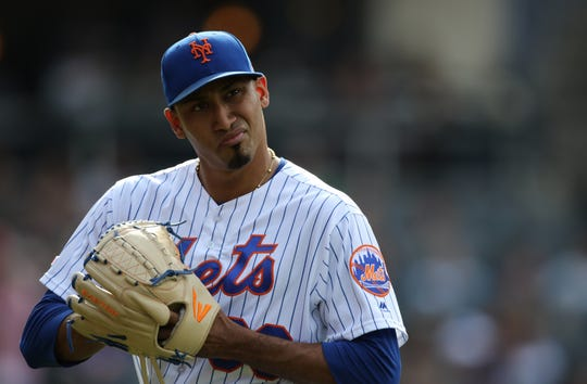 Edwin Diaz, of the Mets, is shown as he heads into the dugout after pitching the ninth inning.  Diaz gave up a two-run home-run during the inning.  The Mets went on to lose, 7-4.  Sunday, August 11, 2019