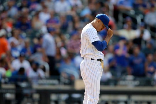 Edwin Diaz, of the Mets,  bows his head after giving up a two-run home-run.  The Mets went on to lose, 7-4.  Sunday, August 11, 2019