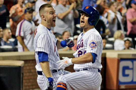 New York Mets' J.D. Davis, right, celebrates his solo home run with Todd Frazier during the fourth inning of a baseball game against the Washington Nationals, Saturday, Aug. 10, 2019, in New York. (AP Photo/Seth Wenig)