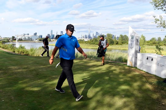 American golfer Patrick Reed walks onto the 18th tee before winning The Northern Trust on Sunday, August 11, 2019, in Jersey City.