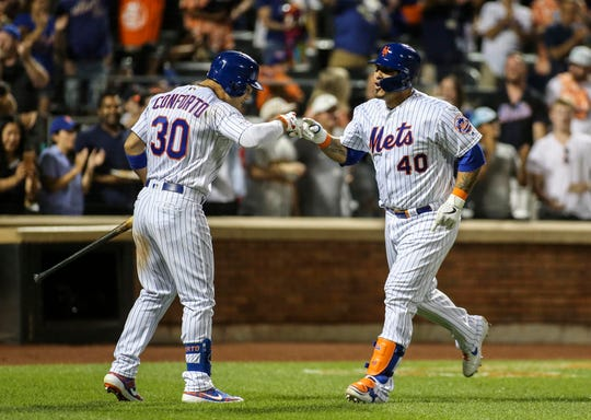 Aug 10, 2019; New York City, NY, USA; New York Mets catcher Wilson Ramos (40) is greeted by right fielder Michael Conforto (30) after hitting a solo home run in the fourth inning against the Washington Nationals at Citi Field. Mandatory Credit: Wendell Cruz-USA TODAY Sports