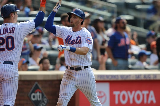 Jeff McNeil, of the Mets, celebrates his run with Pete Alonso (20). It was the last run the Mets would score Sunday, as they lost, 7-4 against the Nationals.  Sunday, August 11, 2019