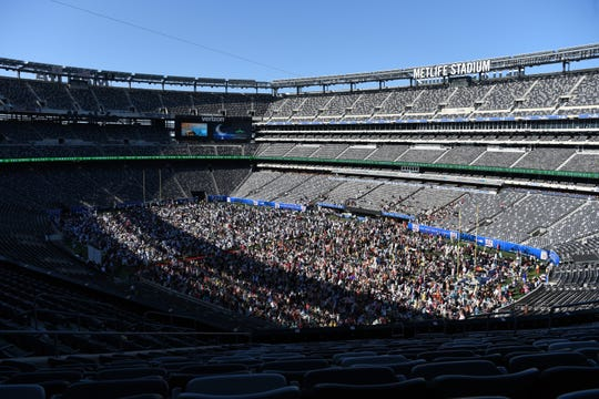 Thousands of Muslims attend Eid al-Adha prayer service, marking the last of day of the Hajj pilgrimage, at MetLife Stadium on August 11, 2019. Organizers estimate 30,000 Muslims attended from New Jersey, New York, Pennsylvania and Maryland.