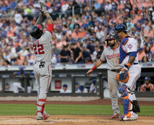 Washington Nationals' Juan Soto, left, reacts after crossing home plate after hitting a two-run home run during the first inning of a baseball game against the New York Mets, Saturday, Aug. 10, 2019, in New York. (AP Photo/Seth Wenig)