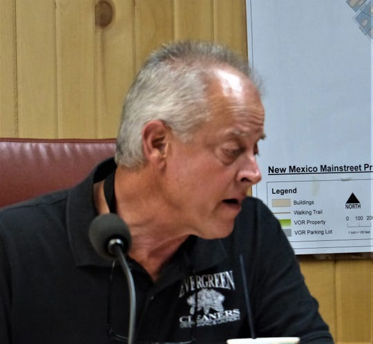Planning Commissioner Bart Byars recused himself from the deliberation and the vote, because his Evergreen Cleaners business is located near the tower site.