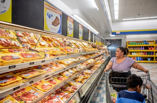 "Antoinette Martinez does her weekly grocery shopping at FoodMaxx on July 26, 2019. According to Martinez, the price of meat has increased significantly making it harder for her to provide ""good meals"" for her herself and her son."