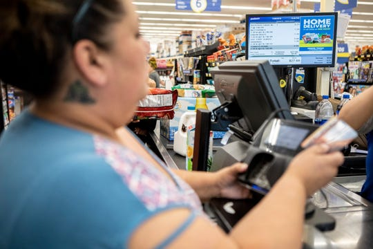 Antoinette Martinez uses CalFresh to pay for her groceries at FoodMaxx on July 26, 2019. The food she purchases today is expected to last her and her five-year-old for at least a week.