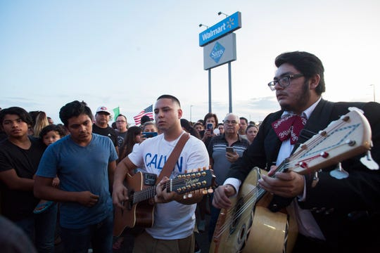 Josue Rodriguez (center) is flanked by Israel Cuevas (left) and Alejandro Ramos. They sang a traditional trio at the Walmart in El Paso where 22 people were shot dead on Aug. 3, 2019, in El Paso, Texas.
