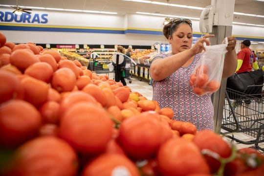 Antoinette Martinez does her weekly grocery shopping at FoodMaxx on July 26, 2019. When choosing her fruits and vegetables Martinez, who receives CalFresh, will not buy an item if it costs more than a dollar per unit.